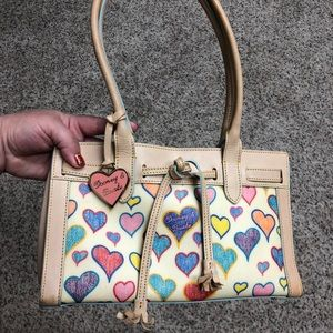 Small  cream heart print Dooney and Bourke purse.